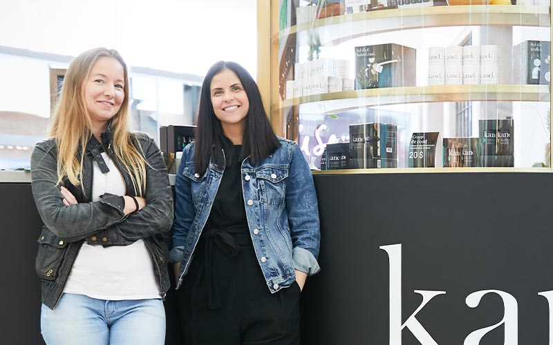 Kim and Camille stand in front of a Kanel counter.